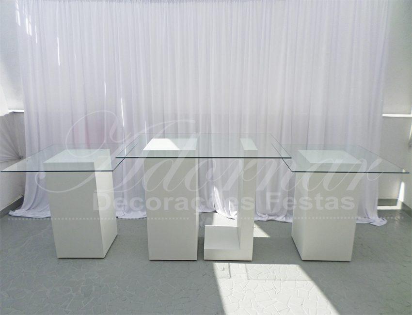 Aluguel de Mesas de Vidro Trio de Mesas Coluna L e Cubos Trio Mesa Menor 1